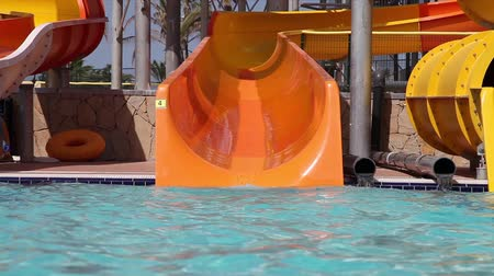 slayt : Little girl sliding down on water slide in waterpark