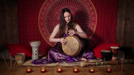 vurmalı : Young woman playing drum, ethnic musical instrument