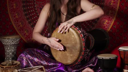 vurmalı : Woman playing drum indoors