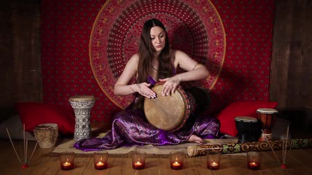 vurmalı : Young Caucasian woman playing drum, ethnic musical instrument