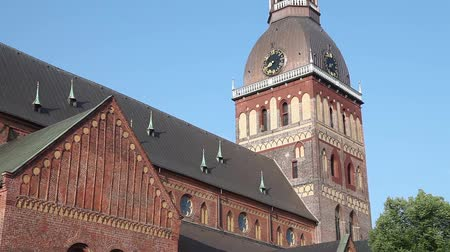 evangelical : Tilt up video shot of Riga Cathedral early in the morning on a sunny summer day. Riga, Latvia