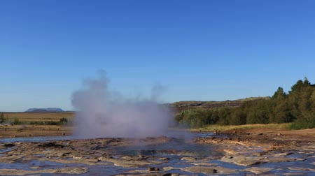 strokkur : Famous Geyser eruption in a sunny day, Iceland