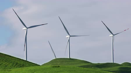 natural resource : Wind turbines with blue sky on farm field