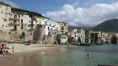 CEFALU, ITALY - APRIL 14, 2019: Panoramic view of the coastal line of the central part of the Sicilian town of Cefalu on a sunny spring day. Cefalu is one of the major tourist attractions in the Sicily region, Italy Стоковые видеозаписи
