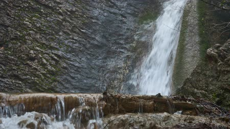 полный : Waterfall, stream of water falling from a cliff