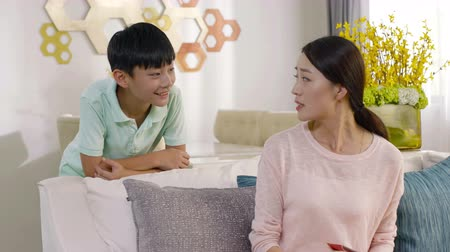 nem sikerül : Asian boy fails to get mothers approval at living room