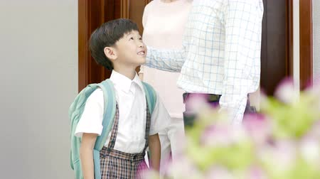 see off : Asian parents opening door for son to walk out to go to school