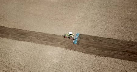 plough land : Tractor Field cultivation, Field preparation to plant, aerial view
