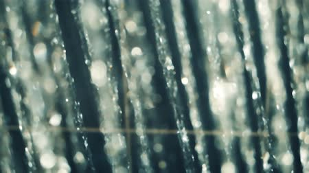 Blurred Shower flowing close up, slow motion, Falling water drops slow motion