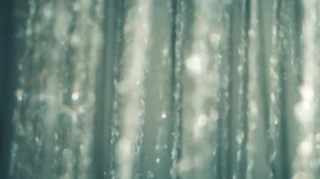 shower room : Blurred Shower flowing close up, slow motion, Falling water drops slow motion