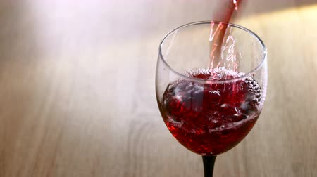 red wine pouring into a glass on light background Dostupné videozáznamy