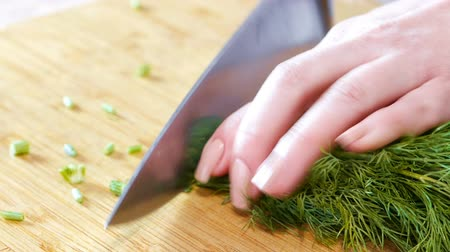 woman cook cuts dill hands close-up