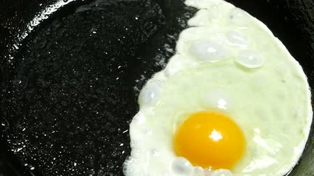 cooking fried eggs in vegetable oil