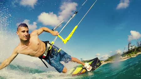extremo : Young Man Kite Boarding in Ocean at Sunset. Summer Extreme Sports  in Slow Motion HD.