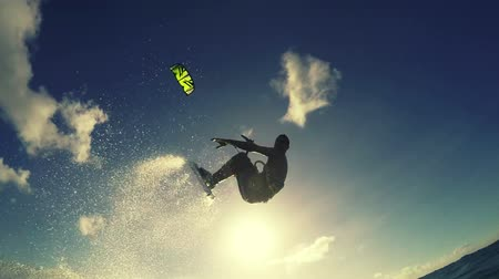 acrobata : Young Man Catching Big Air Kitesurfing in Ocean. Extreme Summer Sport HD in Slow Motion. Stock Footage