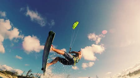 extremo : Young Man Kitesurfing in Ocean. Extreme Summer Sport HD. Slow Motion.