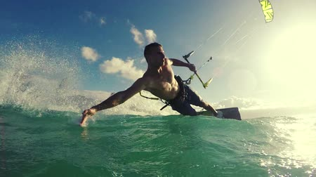 acrobata : Young Man Kite Boarding in Ocean. Extreme Summer Sport in Slow Motion.