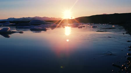 ısınma : Incredible Sunrise at Glacier Lagoon with Floating Icebergs. Global Warming Concept. Stok Video