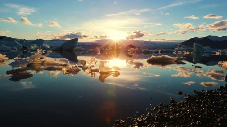 climate : Icebergs Lighting up like Crystals During Sunrise in Glacier Lagoon. Aerial Shot. Iceland.