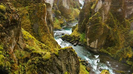 alpy : Aerial View Through Green Mountain River Canyon in Iceland.