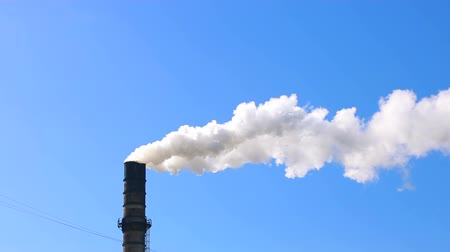 powerful : Polluting factory emitting dirty smoke against clear blue sky