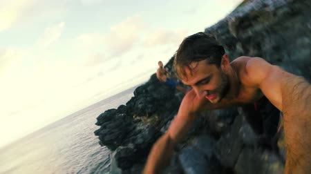 cliff : Extreme POV Cliff Jump into Ocean in Hawaii. Slow Motion.