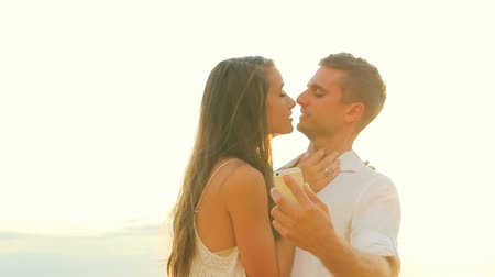 selfie girl : Young Happy Couple Taking Selfie Self Portrait and Kissing Outside At Beach