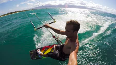 vodní sporty : Extreme POV Shot of Young Man Kiteboarding on a Beautiful Sunny Day in Hawaii. Slow Motion HD.