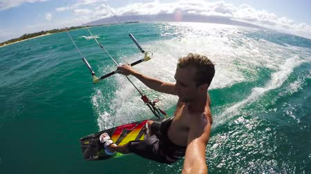 prancha de surfe : Slow Motion POV Shot of Young Man Kite Surfing
