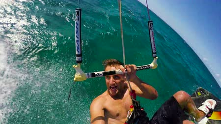 extremo : Kiteboarder Backflip in Slow Motion POV. Extreme Summer Water Sports.
