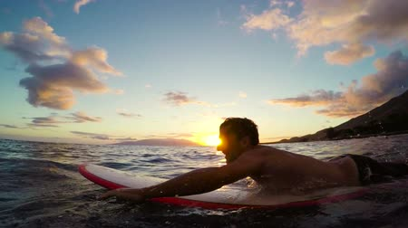 surf : Surfer Paddles out in Slow Motion at Sunset.