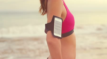 lassú : Young Woman with Fitness Arm Band Smartphone Holder. Lens Flares.