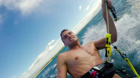 vodní sporty : Healthy Extreme Outdoor Summer Lifestyle. Young Man Kitesurfing Back Flip POV Angle. Extreme Sports.
