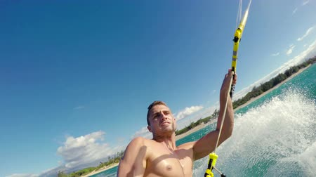 acrobata : Healthy Extreme Outdoor Summer Lifestyle. POV Young Man Kitesurfing in Ocean. Extreme Summer Sport HD. Stock Footage