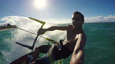 vodní sporty : Healthy Extreme Outdoor Summer Lifestyle. Young Man Kite Boarding in Ocean. Extreme Summer Sport POV Dostupné videozáznamy