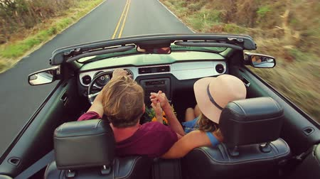ailelerin : Happy Mixed Race Couple Driving Convertible on Country Road. Romantic Freedom Love Concept. Latina Woman from South America and Caucasian Man.