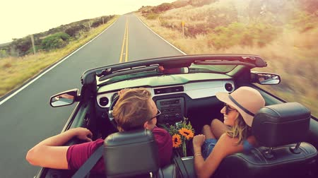 быстрый : Happy Young Attractive Couple Driving Convertible on Country Road. Arms Raised. Romantic Freedom Vacation Concept. 20s-30s.