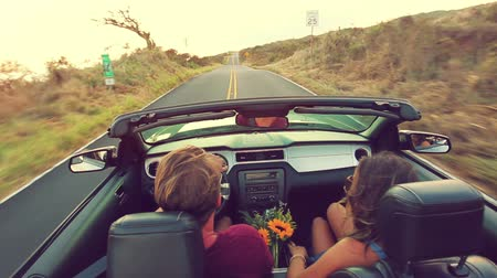 tüyler : Happy Young Attractive Couple Driving Convertible on Country Road. Arms Raised. Romantic Freedom Vacation Concept. 20s-30s.