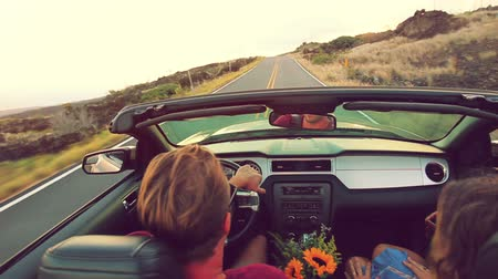 řídit : Happy Young Attractive Couple Driving Convertible on Country Road. Arms Raised. Romantic Freedom Vacation Concept. 20s-30s.