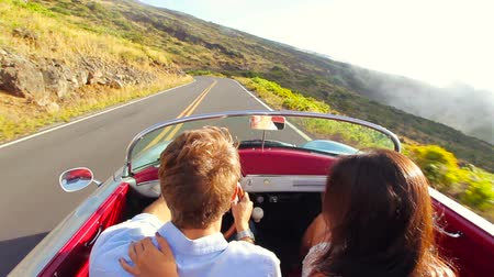 natura : Happy Couple Driving on Country Road in Classic Vintage Sports Car