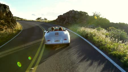 droga : Happy Couple Driving Classic Convertible Car into Sunset on Country Road. Romantic Freedom Relaxing Road Trip Concept. Wideo