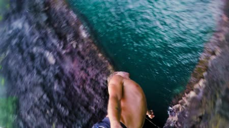 cliff : Extremely High GOPRO POV Young Man Does Flip Off of Cliff Into Water SLOW MOTION. Backflip Gainer