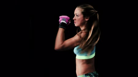 fitnes : A Young Fit Attractive Woman Practices Her Boxing Moves. Self Defense for Women Training. Dramatic Lighting.