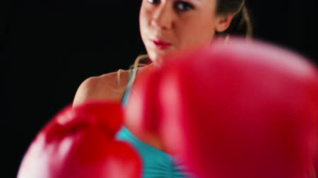bokszoló : Female Athlete Boxing Training. Woman Runs Towards Camera and Practices Throwing Boxing Punches. Healthy Active Lifestyle Stock mozgókép