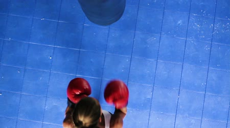 boksör : Athletic Woman Boxing Fitness Training in Gym. Punching Body Bag Shot From Above Looking Down. Women Freedom Healthy Active Lifestyle.