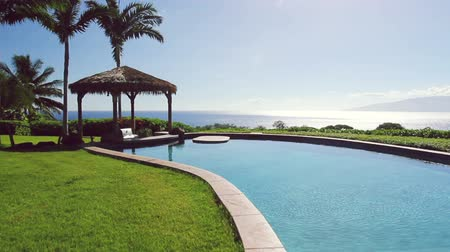 real : Luxury Real Estate Back Yard Pool Area with Ocean View in Maui Hawaii