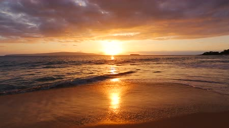 sunset sea : Beautiful Beach Sunset. Smooth Gliding Steadicam Motion. Sun Sets into Pacific Ocean Over Hawaiian Islands.