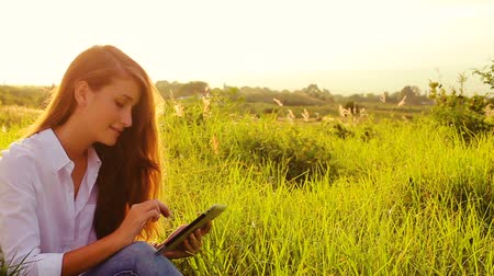 natura : Young Woman Using Tablet Computer Touchscreen. Outdoor Healthy Lifestyle with Modern Technology.
