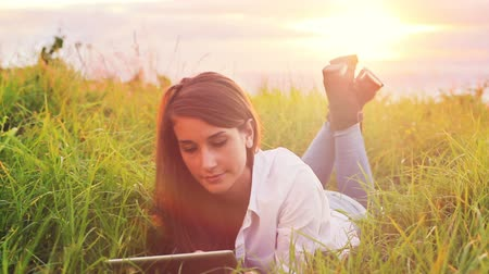 touchpad : Young Woman Using Tablet Computer Touchscreen. Beautiful Vintage Sun Flare Outdoor Healthy Lifestyle.