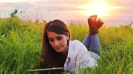 touchpad : Young Woman Using Tablet Computer Touchscreen. Outdoor Healthy Lifestyle with Modern Technology.